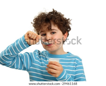 Boy eating yogurt isolated on white background