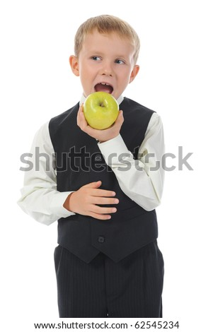 Boy eats a green apple. Isolated on white background - stock photo