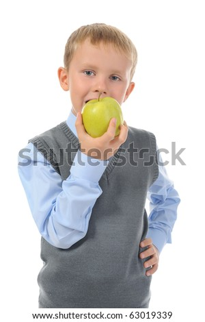 Boy eats an apple. Isolated on white background - stock photo