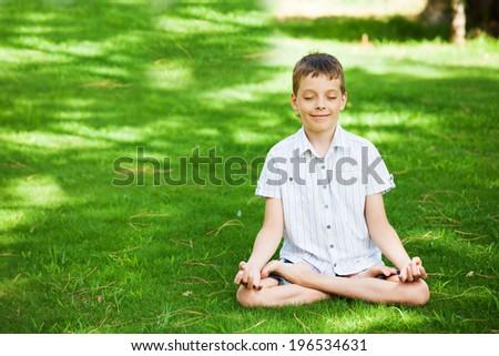 Boy engaged in yoga. Meditation - stock photo