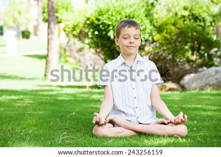 Boy engaged in yoga. Meditation - stock photo