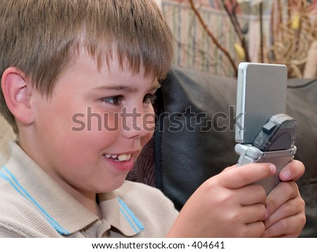 Boy enjoying computer game - stock photo