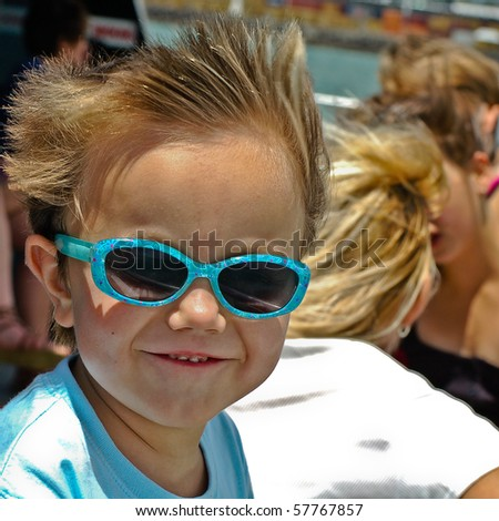Boy enjoying the wind on a ferry in Auckland, New Zealand - stock photo