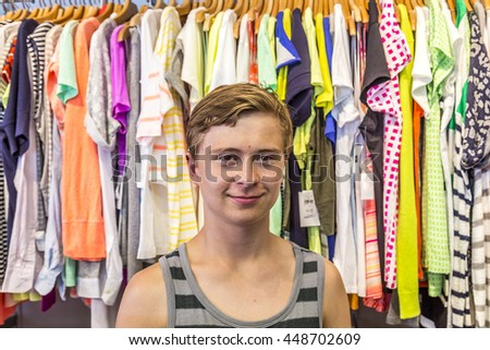 boy enjoys shopping in Miami in Ocean drive by night - stock photo