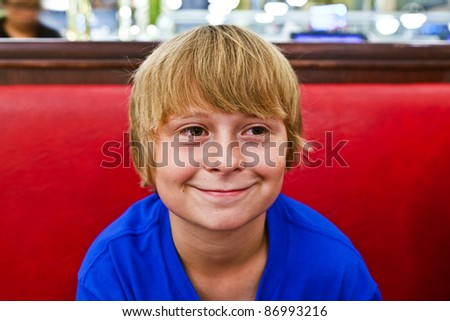 boy enjoys waiting for food in a diner