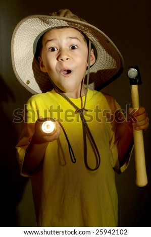 boy exploring with flashlight gets frightened - stock photo