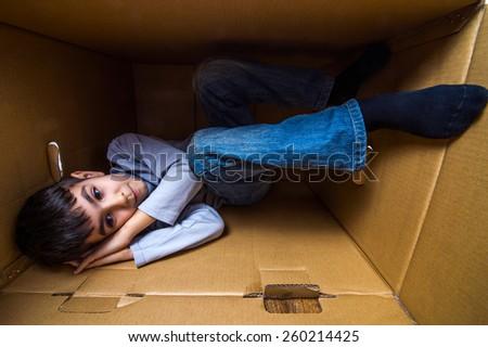 boy fell a sleep in a box - stock photo