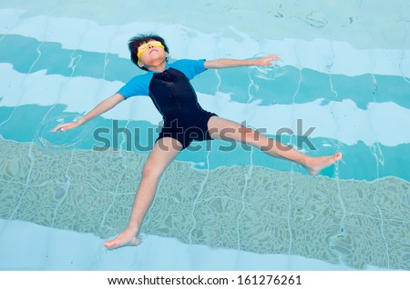 Boy floating in the water.