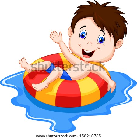Boy floating on an inflatable circle in the pool - stock photo