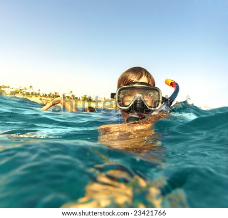 boy floats in the sea ... - stock photo