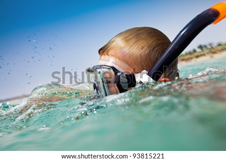 boy floats in the sea - stock photo