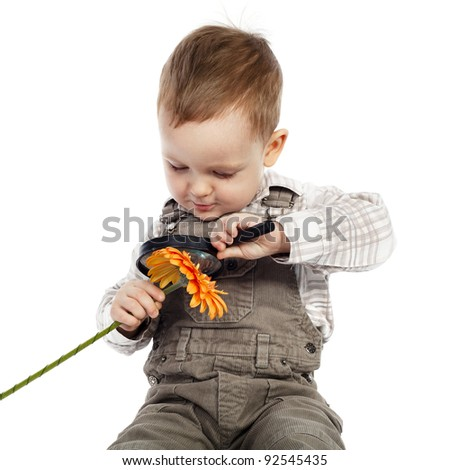 boy flower and magnifying glass