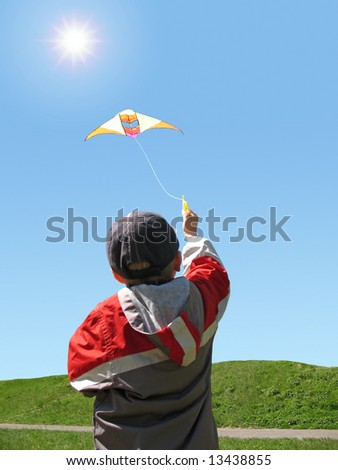 boy fly a kite - stock photo
