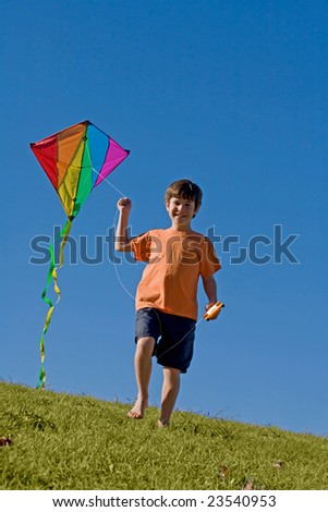 Boy Flying a Kite - stock photo