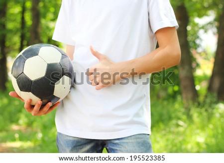 boy football ball in hand Like gesture - stock photo