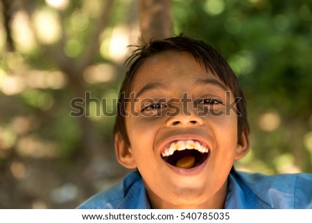 Boy from a small village smiling in India