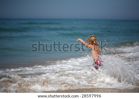 boy from the sea - stock photo