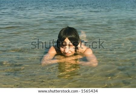 boy gambols in water - stock photo