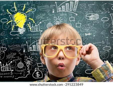 Boy, genius, glasses. - stock photo