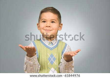 Boy gesturing with his hands - stock photo