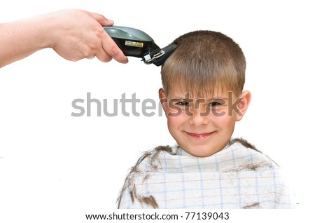 Boy gets haircut. Isolated on white background photo. - stock photo