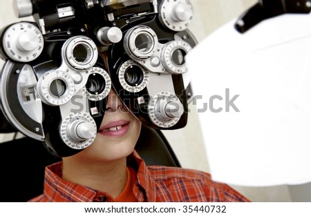 boy getting eye exam - stock photo