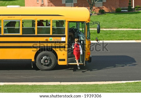 Boy Getting off Bus - stock photo