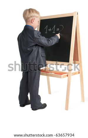 Boy getting ready for math class - stock photo