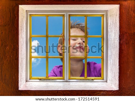 Boy giant winking and looking from the outside in - stock photo