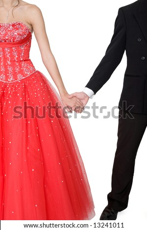 Boy & girl, in formal attire, holding hands against a white background.