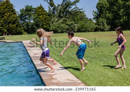 Boy Girl Playtime Pool Boy girls playtime at swimming pool  home summer  - stock photo
