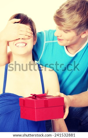 Boy give a gift to his girlfriend. - stock photo