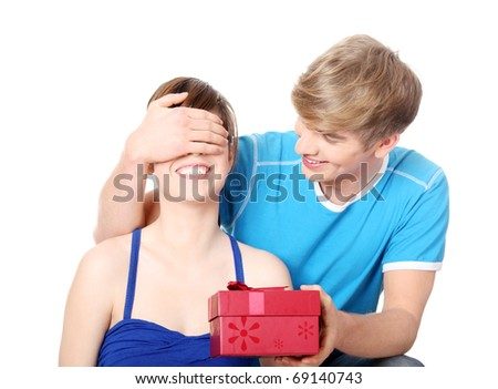 Boy give a gift to his girlfriend. Isolated on white background. - stock photo