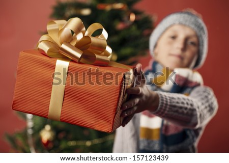 Boy gives gift - stock photo