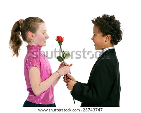 boy giving a rose to a girl, isolated on a white background - stock photo