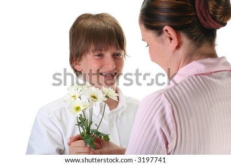 boy giving flowers to his mom, isolated on white