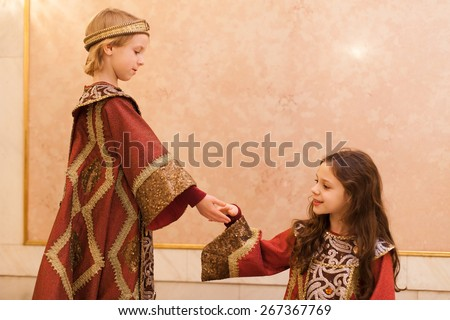 boy giving girl hand during theater play  - stock photo