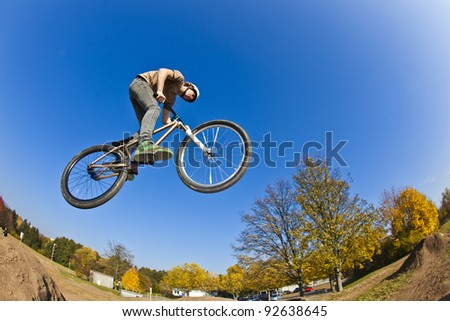 boy going airborne with his dirt bike - stock photo