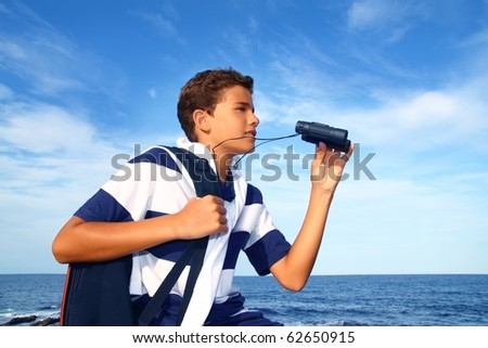 boy handsome teenager summer binoculars explorer in blue beach - stock photo