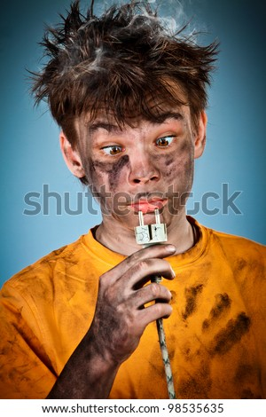 Boy has a electric shock - stock photo