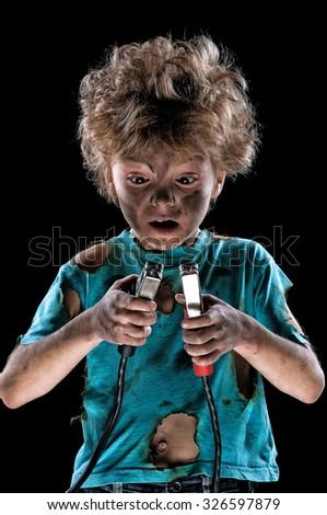 Boy has a electric shock on dark background - stock photo