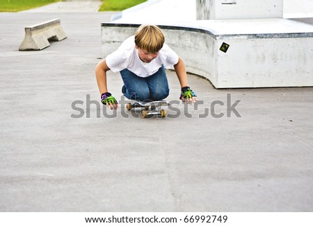 boy has fun by riding his skateboard - stock photo