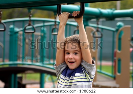 Boy Having a Great Time on Playground - stock photo