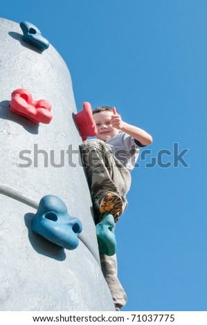 boy having fun on playground - stock photo