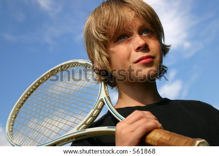 boy heading for a tennis match - stock photo
