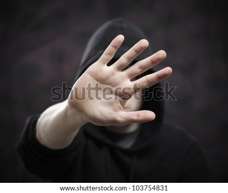 boy hides his face with hand