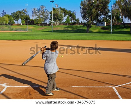 Boy Hitting Baseball