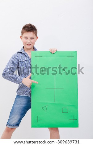 Boy holding a banner on white background - stock photo