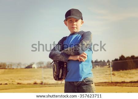 Boy holding a baseball - stock photo