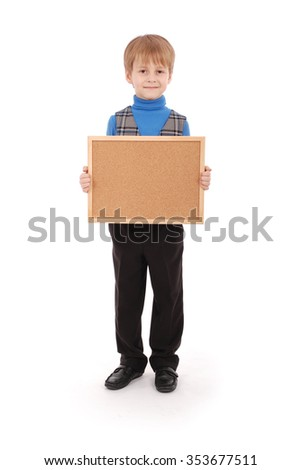 Boy holding a board made of cork isolated on white